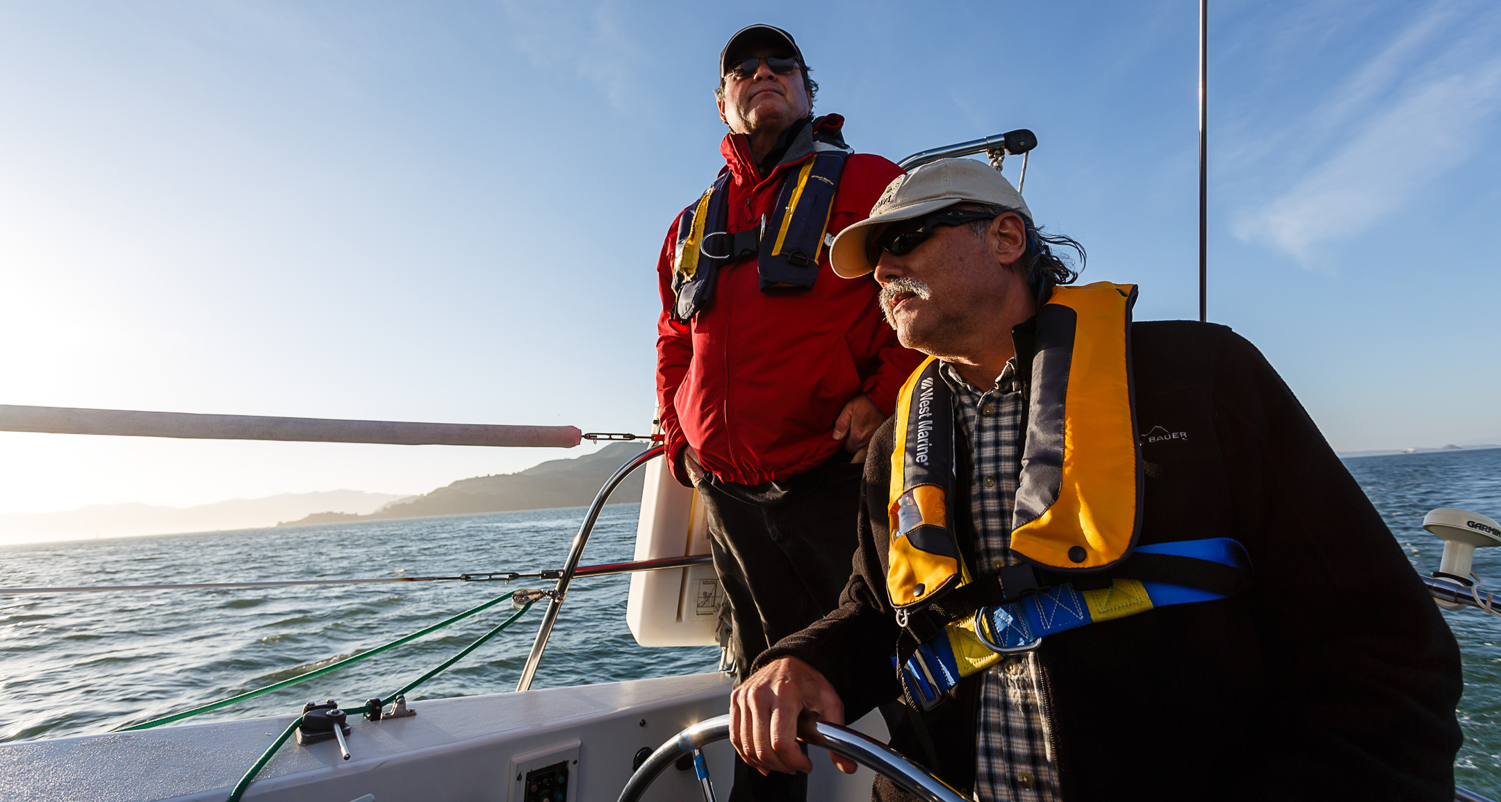 Modern Sailing Member Chuck takes the helm during an ASA 104 Bareboat Cruising Course with Modern Sailing School & Club and Instructor JT Meade