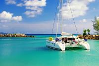 A Luxury Catamaran sits at anchor in a Caribbean Lagoon on an adventure sailing trip with Modern Sailing School and Club and Global Destination.