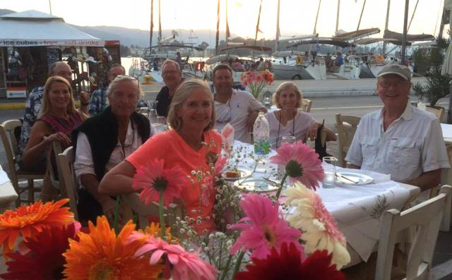 Participants  on Leg One of the Greece Modern Sailing Destinations Trip enjoy a group meal together at one of the many taverns.