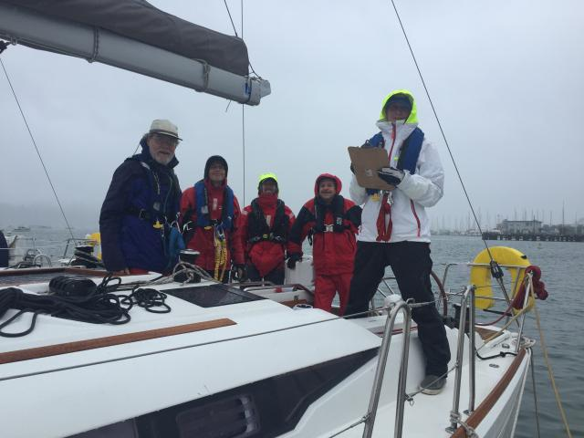 Modern Sailing School and Club Members are dressed in full foul weather gear as they get their sailboat ready for the Heavy Weather Sailing Clinic on San Francisco Bay